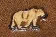 ours mini en négatif sur cuir végétal gravé ou embossé